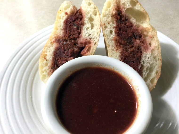 BLOOD RED SAUSAGE MEATBALL SANDWICH WITH KALAMATA RED GRAVY DIP